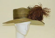 Hat    Date:      1911–12  Culture:      French  Medium:      straw, silk, feathers  Dimensions:      Length (front to back): 14 1/2 in. (36.8 cm)