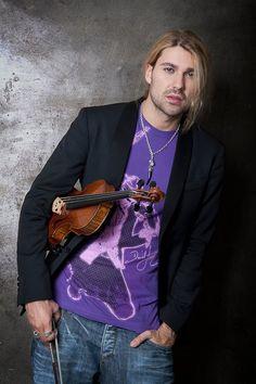 David wearing his own tour shirt.