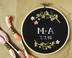 Custom wedding embroidery hoop wall art - spring flowers on black linen, via Etsy.