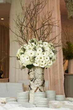 "Awesome large arrangement!  Birch log ""vase"", twigs, hydrangea, gerbera daisies and berzillia berries. Just lovely."