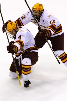 A) this is a cool shot B) this is Gopher hockey C) just so happens to be Seth Helgeson. Great picture.