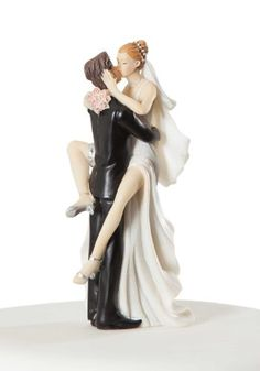 "Humor is well in tow with this funny over-eager sexy bride and groom wedding cake topper. It will be sure to cause quite a stir at your wedding reception or bridal shower. This piece would also be a great addition for a bachelorette party!! Hand painted and made of resin.  Height:	5"" Base Diameter:	2"