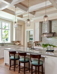 Kitchen with butlers pantry and desk nook in background. Breezy Florida home with coastal colours. Ficarra Design Associates