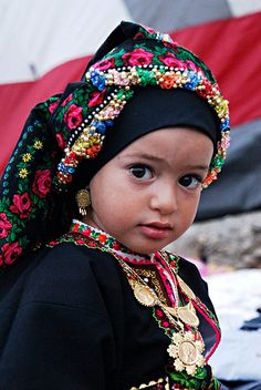 The whole world in her eyes! Little girl in traditional Karpathos costume, Greece