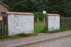 Warsaw-based artist NeSpoon adds a delicate touch to public spaces with her intricately designed lacy patterns. Her elegantly adorned designs beautify a variety of worn and weathered structures, from crumbling architecture and cracked pavements to rotting tree trunks and mossy blocks of concrete.