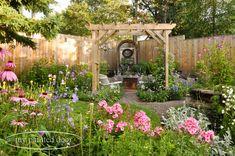 My Country Garden - Sue Sikorski's zone 3 garden - garden arbour with chandelier.