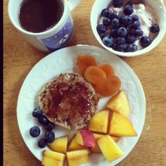 whole grain English muffin with almond butter and a tiny bit of strawberry fruit spread, Greek yogurt with blueberries, peach, dried apricot, and coffee