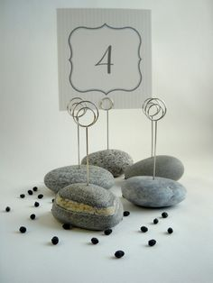 Beach Stone Wedding Table Number Holders in Shades of Gray. $46.00, via Etsy.