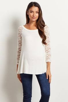 As if the romantic lace sleeve detailing of this maternity top wasn't enough? Maternity clothes with style and comfort always have us sold. This unbelievably soft material is perfect for these cold months ahead and comes just in time to keep us warm.