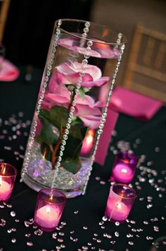 Pink and black crystal wedding vases drippin in crystals