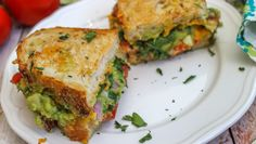 On the Menu for Tomorrow: Guacamole Grilled Cheese Sandwich! you're a grilled cheese fan, here's your next favorite recipe. This sandwich combines some of the best foods ever: guacamole and cheese! Soup And Sandwich, Sandwich Recipes, Vegetarian Recipes, Cooking Recipes, Healthy Recipes, Vegetarian Sandwiches, Yummy Food, Tasty, Yummy Yummy