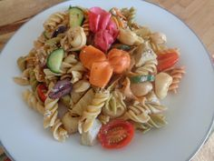 This is one of our favorite salads... Tri-Colored Pasta Salad with tomatoes, artichoke hearts, cucumber, kalamata olives and feta cheese.