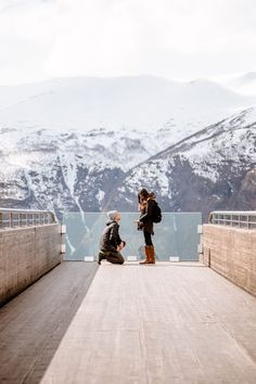 We're swooning over this stunning destination proposal in Norway! He proposed with a perfect view of the snowy mountains, and it's so romantic.