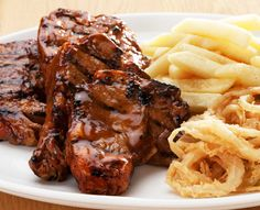 Try our famous ribs or one of the many items off our sizzling grill menu. Served with Spur-style crispy onion rings and chips OR a baked potato. Crispy Onions, Lamb Chops, Onion Rings, Grills, Chicken Wings, Steak, Chips, Menu, Food