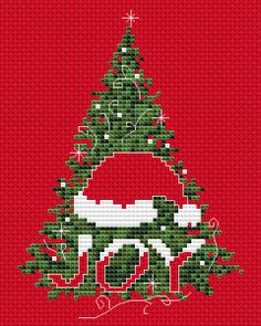"""This card is designed for Christmas red Aida 14 ct and depicts Christmas tree, Santa hat and the text:""""JOY"""""""