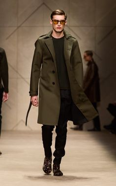 Olive bonded trench coat and animal print Chelsea boots on the runway of the Burberry A/W13 Menswear show