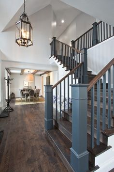 gray railing with wood handrails...and I LOVE those floors!!