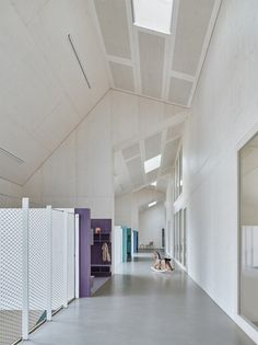 Children & Family Centre in Germany designed by VON M | muted tones, pale ply linings with well chosen features (cubbies & custom furniture) injecting a bit of play