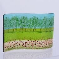 Dream of a summer stroll through fields of poppies, this is an 'S' shaped free-standing fused glass curve. On a background of light amber, spring green and light turquoise glass, the tree and grass design is printed and fired into the glass. In a secon...