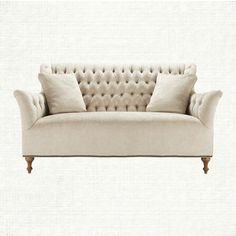 Graceful tufting, an elongated back, gently flared arms and nailhead detail combine to create this stunning sofa. Fiona's fabric, a vintage chenille
