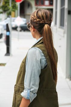 Braided Ponytail - 1. To avoid flatness at your crown, take a fine tooth comb and tease the roots, only of the top/back area.  2. Create a side part and French braid your hair on each side, starting at your temple and working your way back.  3. Once the two braids meet, stop adding new hair and braid the two braids together until you reach the ends. Temporarily secure your ends with an elastic.