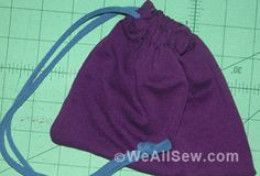 recycle - drawstring pouch made from t-shirt sleeves.  The drawstring cord is also a strip of a discarded t-shirt.
