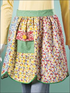 """Vintage-Look Apron      Technique - Sewing    Create a retro-chic fashion accessory by stitching this fat-quarter apron in no time. Made of reproduction prints from the '30s, it makes a great gift for a cook of any age. This e-pattern was originally published in Sew Special Fat Quarter Gifts.     Size: 20"""" at front band x 20"""" long."""
