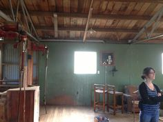 The wall behind and to the left of the shearing stand could be blackboard paint, in the kids corner here