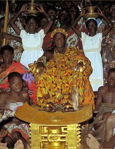 Africa   The king of the Abron in Ivory Coast, Nana Kofi Yeboa, wears a sumptuous cloth and a rich display of gold jewellery as he sits in state with his gold-covered stool.  1986. | ©Monique Barbier-Mueller.  royals