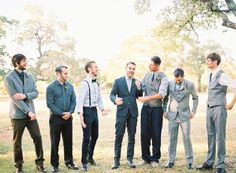 Mismatched groomsmen with a combination of suit jackets, suspenders, bowties, and ties for a fall wedding.