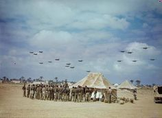A magnificent original colour image of the South African Air Force in North Africa during World War 2. May 1943. Seen here os a South African Squadron of Douglas Boston aircraft returning from a sortie to the Mareth Line in North Africa while another squadron is briefed in the foreground. Image copyright: The Imperial War Museum