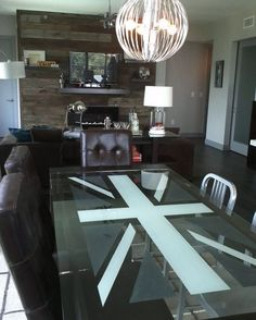 Contemporary glass dining table showcases the Union Jack