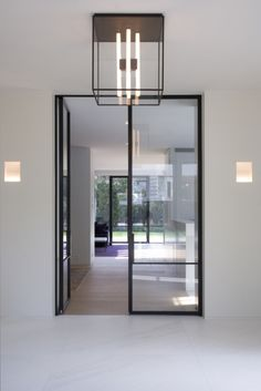 While a glass door competes tightly in a home décor realm, here's how to choose the right glass door design that'll fit your house. Interior Architecture, Interior And Exterior, Interior Glass Doors, Hall Interior, Interior Paint, Door Design, House Design, Steel Frame Doors, Interior Minimalista
