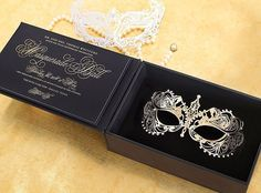 When your invitation is also your costume!  Masquerade Ball invitation with laser cut gold mask in a handmade leather box. by Southern Fried Paper
