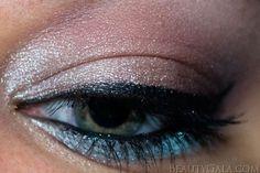 Neutral eyeshadow with a pop of aqua-mint.