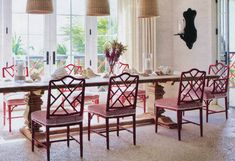 Red Chinese Chippendale Chairs with patterned fabric seat covers | Design by Alessandra Branca