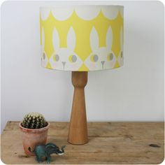Happy Bunny lampshade made by Rebecca Södergren.   A beautiful, scandi inspired lampshade in yellow and cream.  Diameter 30cm, it can be made with either a lamp or pendant fitting.   Ideal for a child's nursery, bedroom or even a lovely feature for a stylish grey inspired room.    #children'sbedroom #nurseryideas #scandidesigns #cushion #matchinglampshadeandcushion