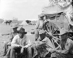 LS cowpunchers taking time for a smoke in roundup camp. This outfit operated near Tascosa. LS Ranch, Texas, 1908
