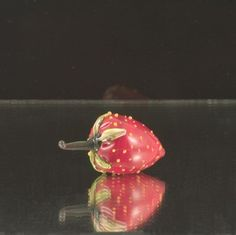 A glass strawberry. Made with Moretti glass on Torch.