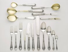 An Extensive Fabergé Silver Flatware Service, Moscow, 1908-1917。in the Neoclassical taste, comprising: twelve dinner knives with original steel blades, twelve dinner forks, twelve table spoons, twelve luncheon knives with original steel blades, twelve luncheon forks, twelve teaspoons, twelve fish forks, twelve dessert knives with silver blades, eleven dessert forks with silver tines, twelve dessert spoons, twelve demitasse spoons, six salt cellars, five salt spoons, and eleven serving pieces