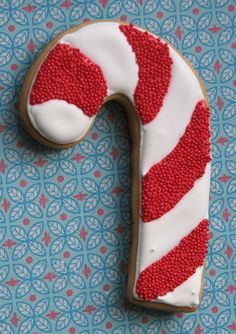 candy cane with stripes alternating between sprinkles and frosting -- tone on tone would be fun