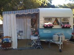 love the window boxes & canopy  vintage travel trailer  shasta  blue