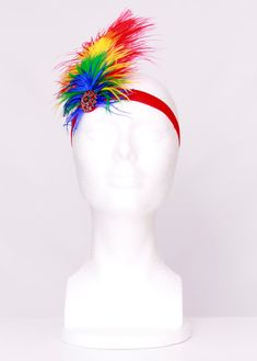 This listing is for one Paradise Parrot feather headband. ***This item is ready to ship. ****Tutu dress not included. ****Arm Wings not included. ****Leg Warmers not included. --------------------- ITEM DETAILS --------------------- Red, orange, yellow, green and blue feathers