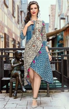 Get This Artistic #Asymmetric #Designer #Multicolor Angrakha #Kurti For Jeans #Online. This Mod Girls #Designer #Printed #Top Contains 3 4th Sleeves & Boat Neck. #Designers#And#You