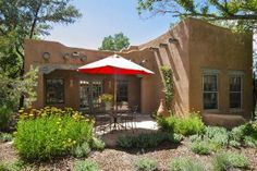 Enjoy a glass of wine on the covered portal and bask in the true Santa Fe flavor of this classic adobe in the heart of the Guadalupe/Railyard neighborhood. The open kitchen, dining and living area surround a dual, sculptured kiva fireplace that you can enjoy from either area. The kitchen has custom cabinets and all the necessities for a nice meal at home. There is a flat screen TV in the Master bedroom as well as the Living area. The private yard, is surrounded with a coyote fence, ...