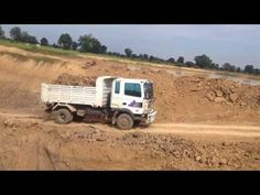 Excavator digging in deep hole | Cat excavator loading the truck | Best ...