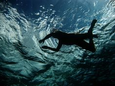Being completely submerged, feeling weightless and free.