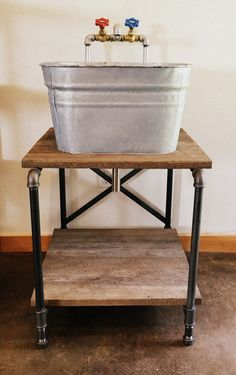 Galvanized sink with industrial pipe base & faucet & Reclaimed barn wood by SteelHouse Designs. facebook.com/steelhousedesigns @designsbySH