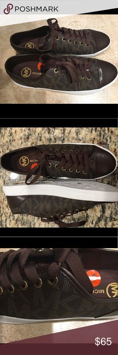 NWT Michael Kors 9.5M Leather Logo Sneakers Shoes New with tag! Size 9.5M. Color Brown. Get this now for a steal! All reasonable offers are welcome. Sorry, no trades. Michael Kors Shoes Sneakers