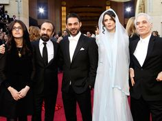 "Asghar Farhadi, (2nd L) director of Iranian film ""A Separation"", winner of foreign language film, arrives with actors Peyman Maadi (3rd L), Leila Hatami (2nd R) and two unidentified guests at the 84th Academy Awards in Hollywood, California, February 26, 2012."